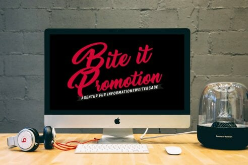 Desktop with Bite it Promotion Logo